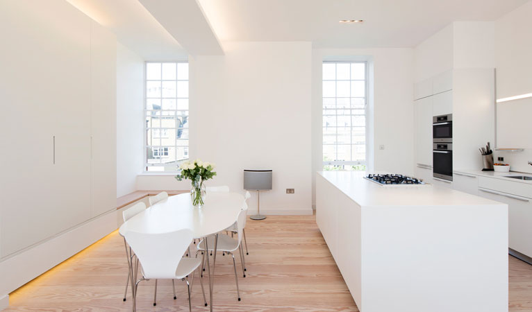 Dinesen solid oak flooring with bespoke joinery unit featuring low & high level mood lighting in Covent Garden WC2