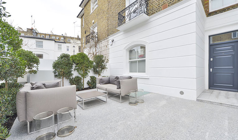 Granite Courtyard in Chelsea SW7 with seating area & glazed patio roof light