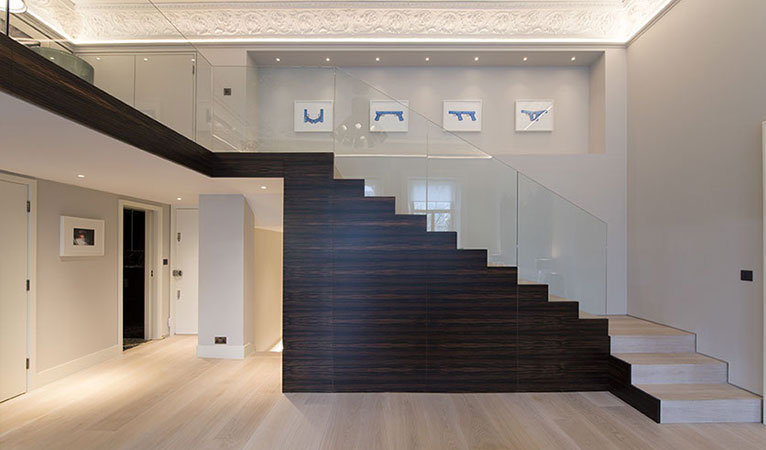 Macassar high quality wood staircase, low-iron toughened glass balustrade in Kensington apartment