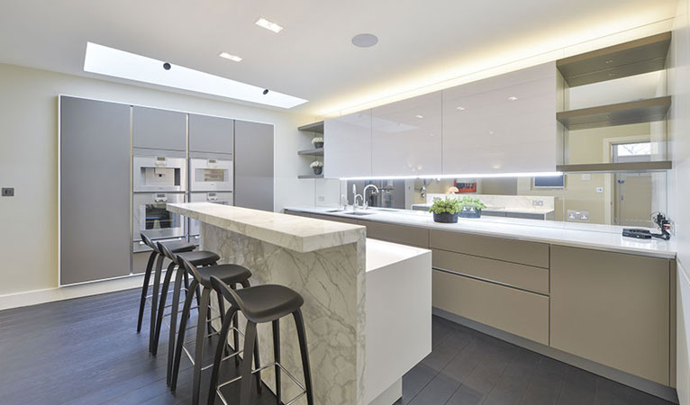 Beautiful kitchen with evidence of natural light through roof light in Chelsea SW7
