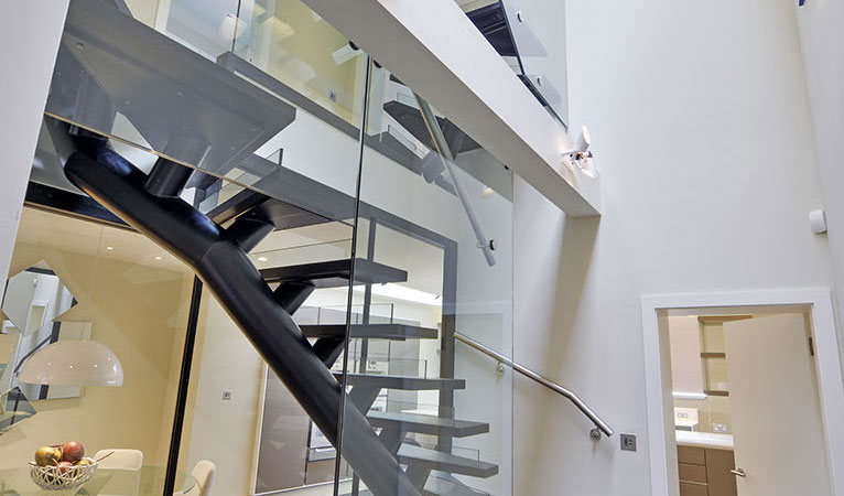 Internal view-custom made self-supporting staircase with Ebonised Oak hardwood floating treads in Chelsea SW7