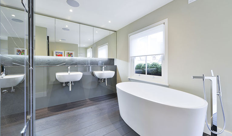 Top floor master En-suite Bathroom in Chelsea with freestanding bath, double sinks, Dormbracht taps & shower fittings
